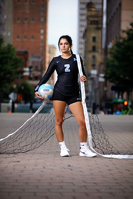 Volleyball senior picture with net downtown