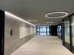 Passage à la Rue des Bains 35, Genève avec Lumiverre Plafonds - une société du groupe Cat