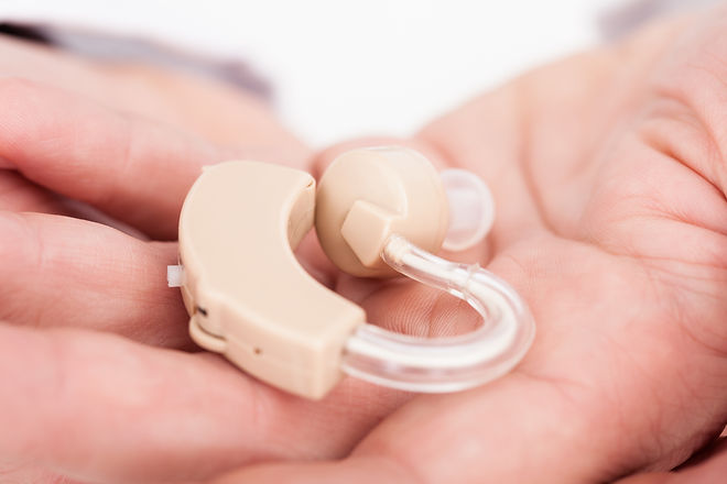Close-up Of A Hearing Aid On Person's Pa