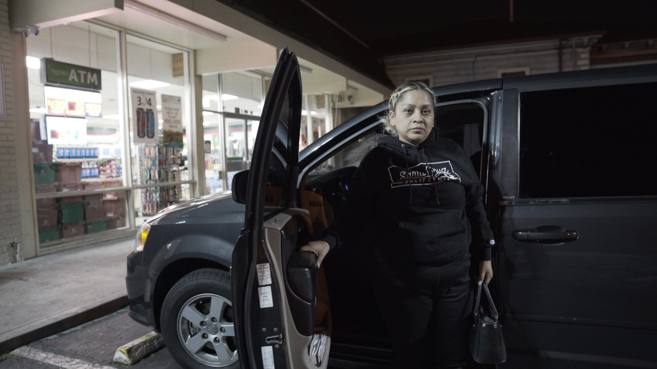 Angelina exits her van, where she lives, to go shopping at a 711 before work in Sillicon Valley, California.