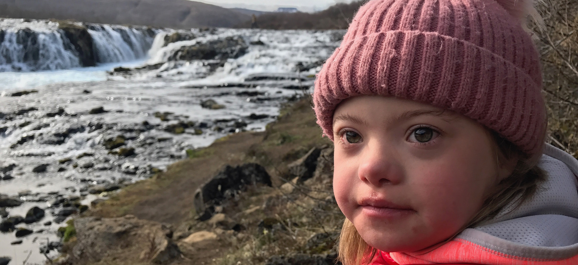 Still from CBS News' 'Disappearing Downs' at Bruarfoss Waterfall, Iceland.  As genetic testing increases in Iceland, Agusta, 7 years old, is part of a declining population of people with Down Syndrome in the country.