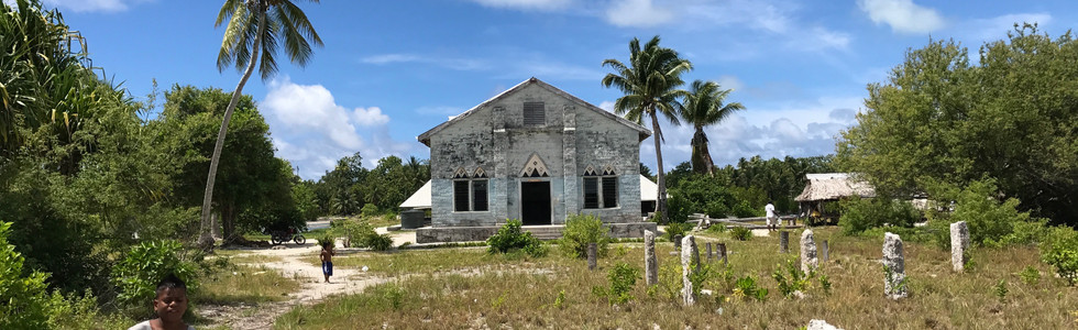 Still from CBS News' 'Climate Refugees'. A young boy stands in front of the christian church on the remote island of Abaiang, Kiribati.