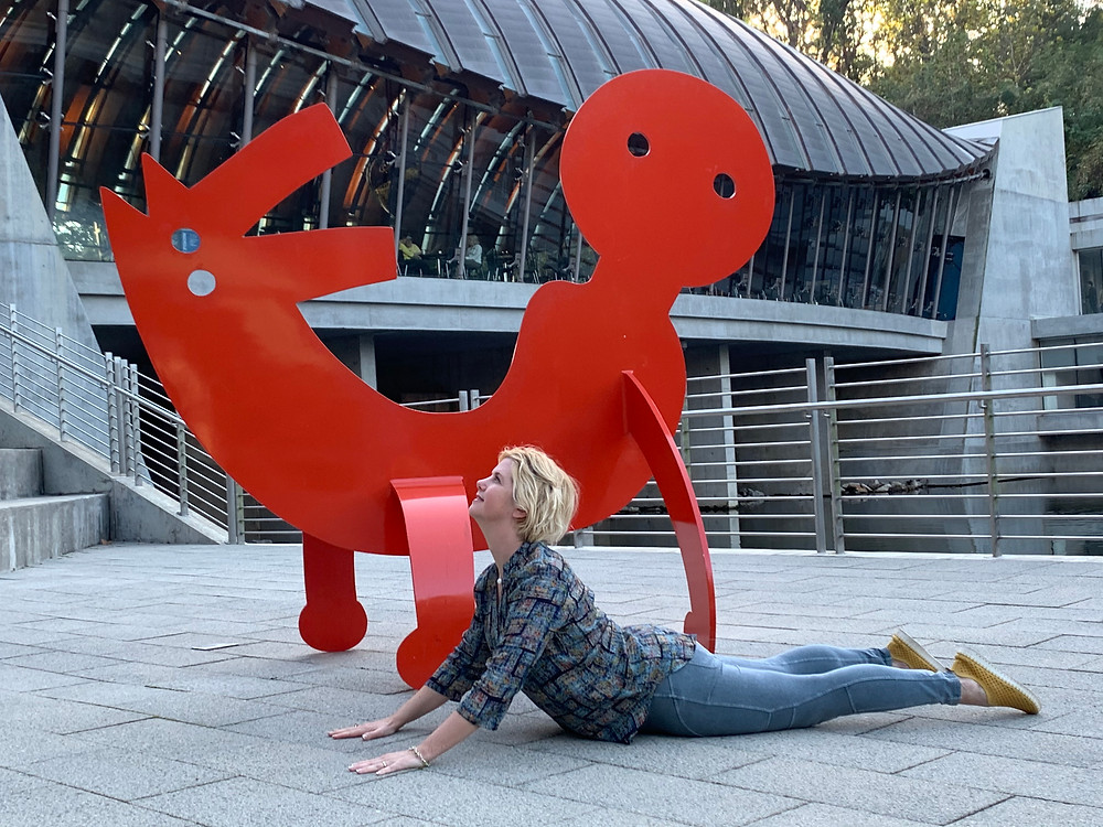 One of hundreds of photos of Lyn stretching in unusual places. (Crystal Bridges Museum)