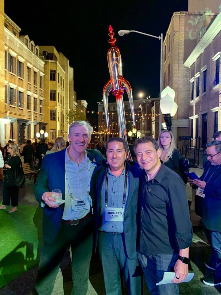 Erik Lindbergh, Richard Kane, and Peter Diamandis at the XPRIZE 25th Anniversary Celebration. Rocket in the background was created by Erik.