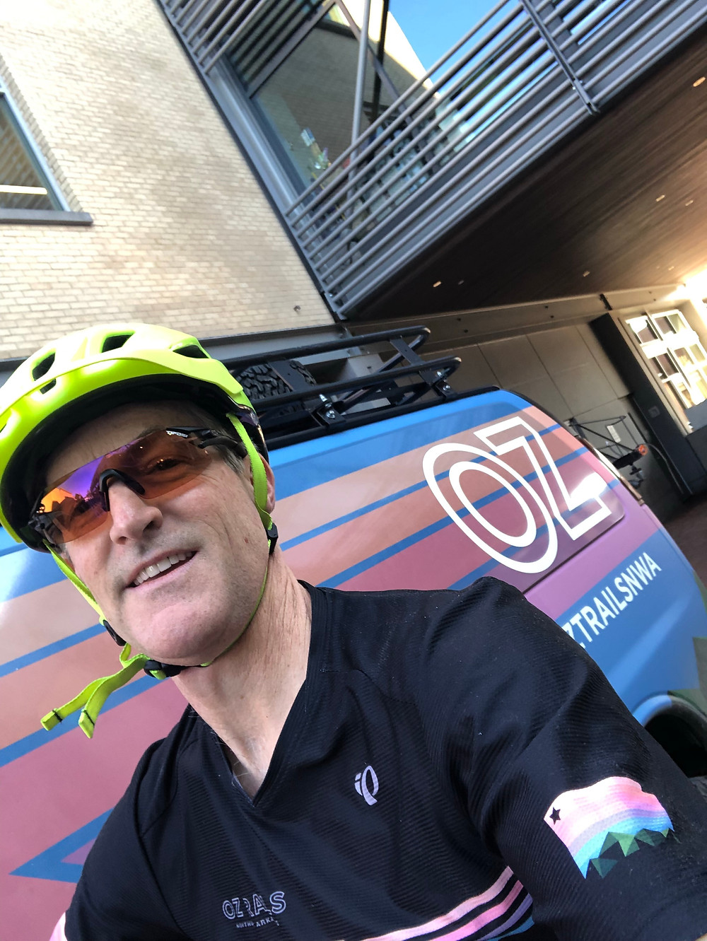 Erik in front of an OZ trails van. This is an example of the rainbow branding Gary mentioned in the podcast.