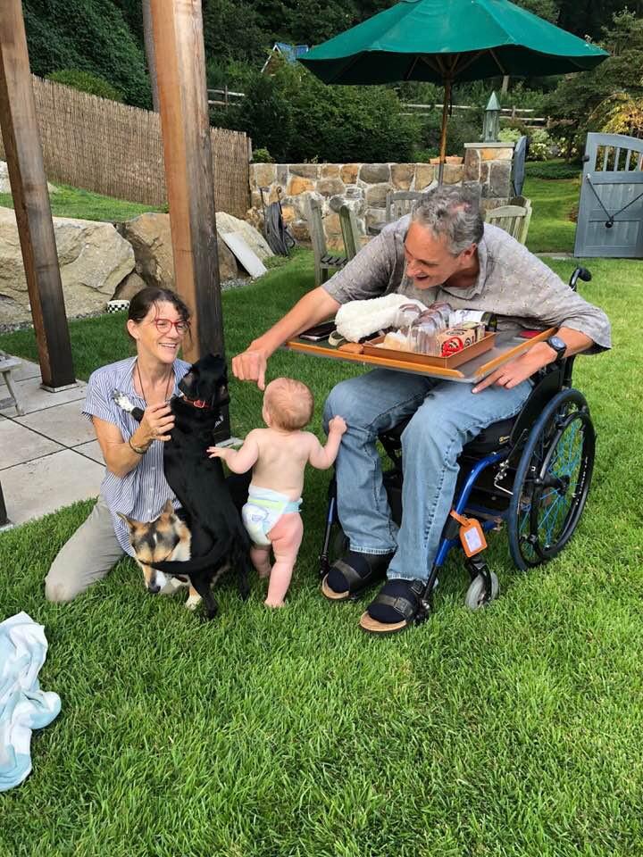 Kristina Lindbergh and Bob Conte with their grandchild.
