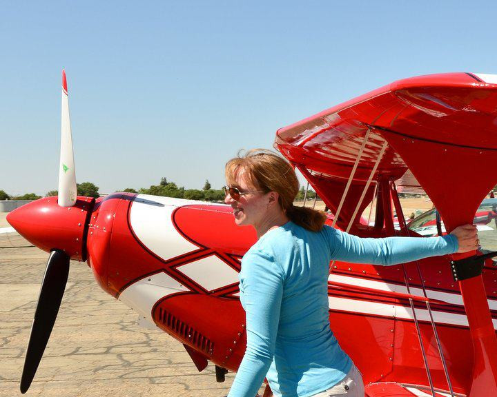 Happiness is a red Pitts biplane.