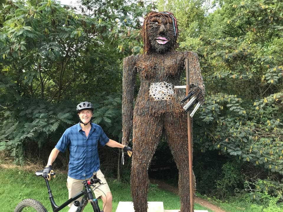 Erik and his new best friend. Look closely, it's make entirely out of bike chains and bike parts.