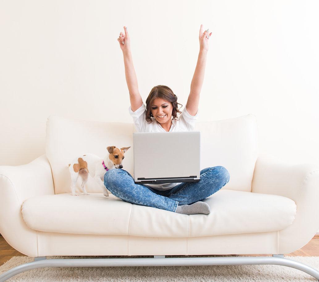 Joyful  woman using laptop on the sofa.jpg