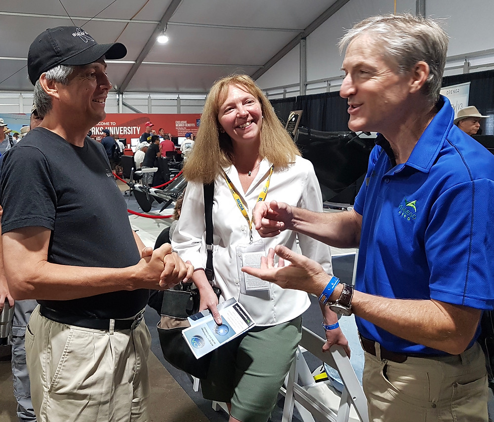 Beth with innovators at AirVenture 2019, Marcus Leng of BlackFly and Eric Lindbergh of VerdeGo Aero.