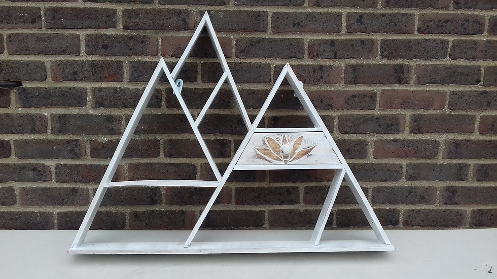 Triangular shaped white wash shelving unit with small drawer