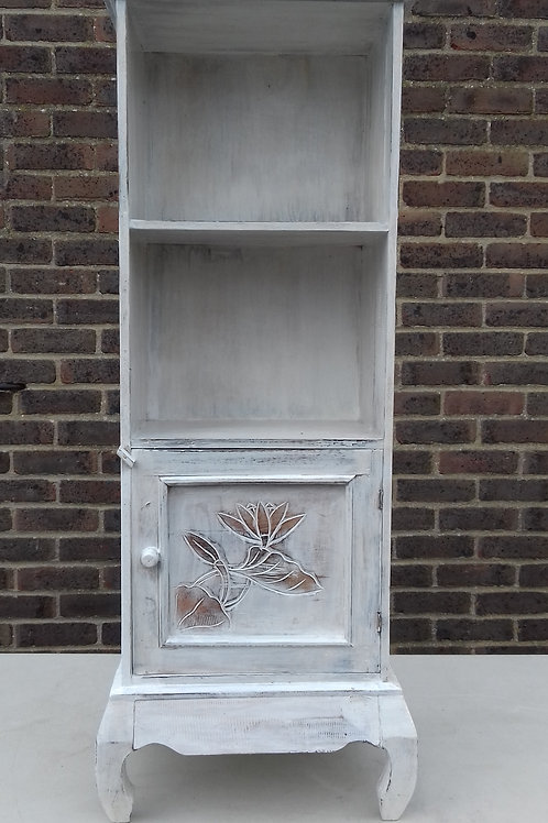 Tall whitewash shelves and cupboard