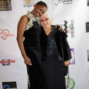 Photos of Gina Carey and grandma Genevie