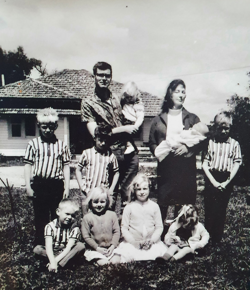 Pictured is Dad (holding Patsy), Mum (holding Jackie), Stephen, Peter, Leonard, and in front: Rory, Sally (me), Bridget and Katie.