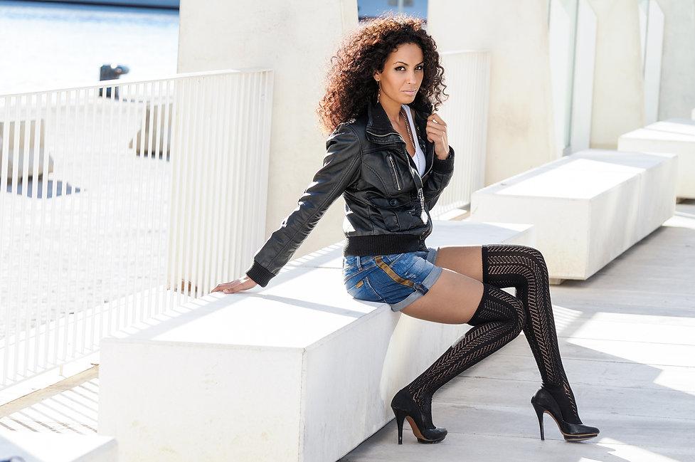 Black female, afro hairstyle, in urban b