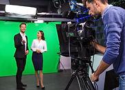 Presenters In Studios Green Screen. smal