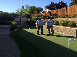Turf Brothers (Brandan and Conrad) installing putting green