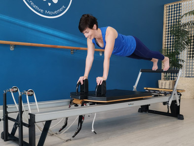 Sue on the reformer at Fit Panda