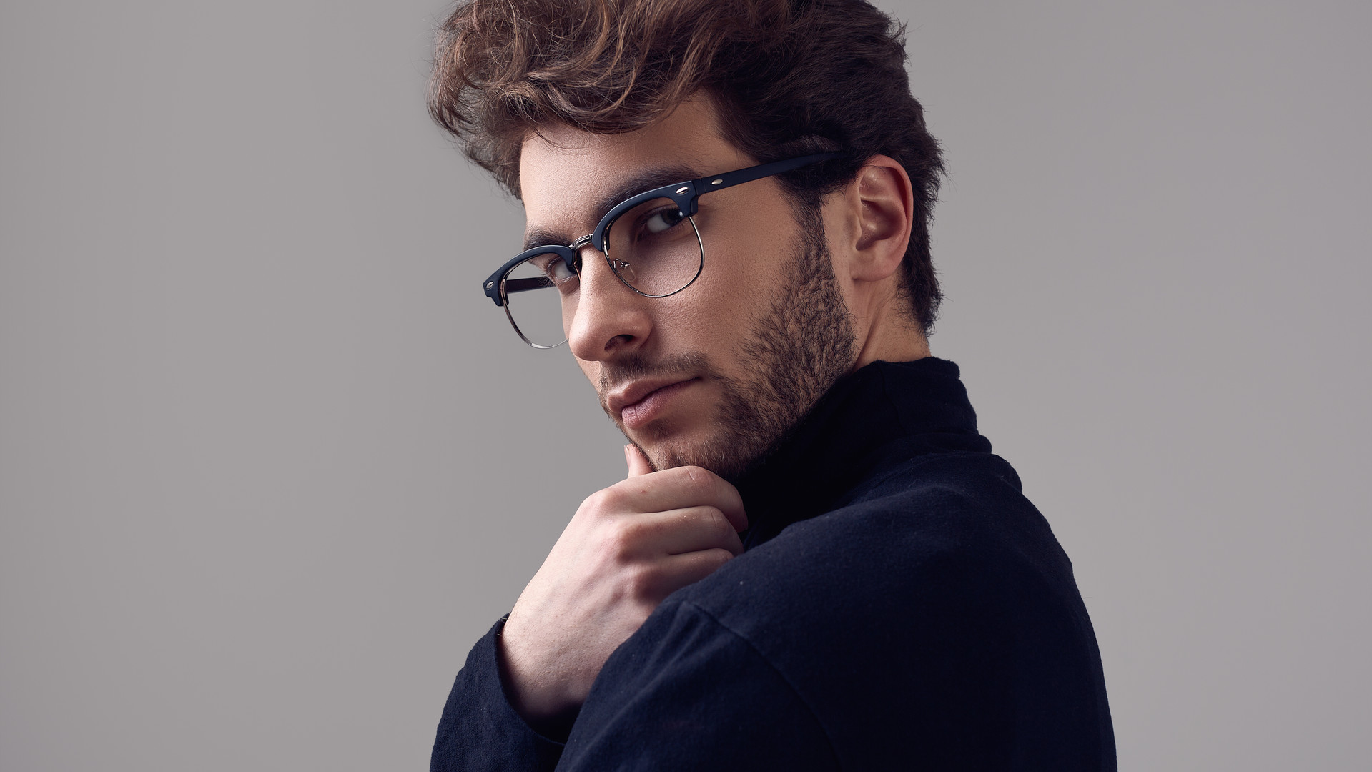 handsome-elegant-man-with-curly-hair-wea