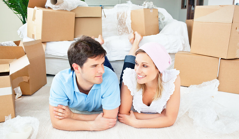 young-couple-lying-floor-after-unpacking
