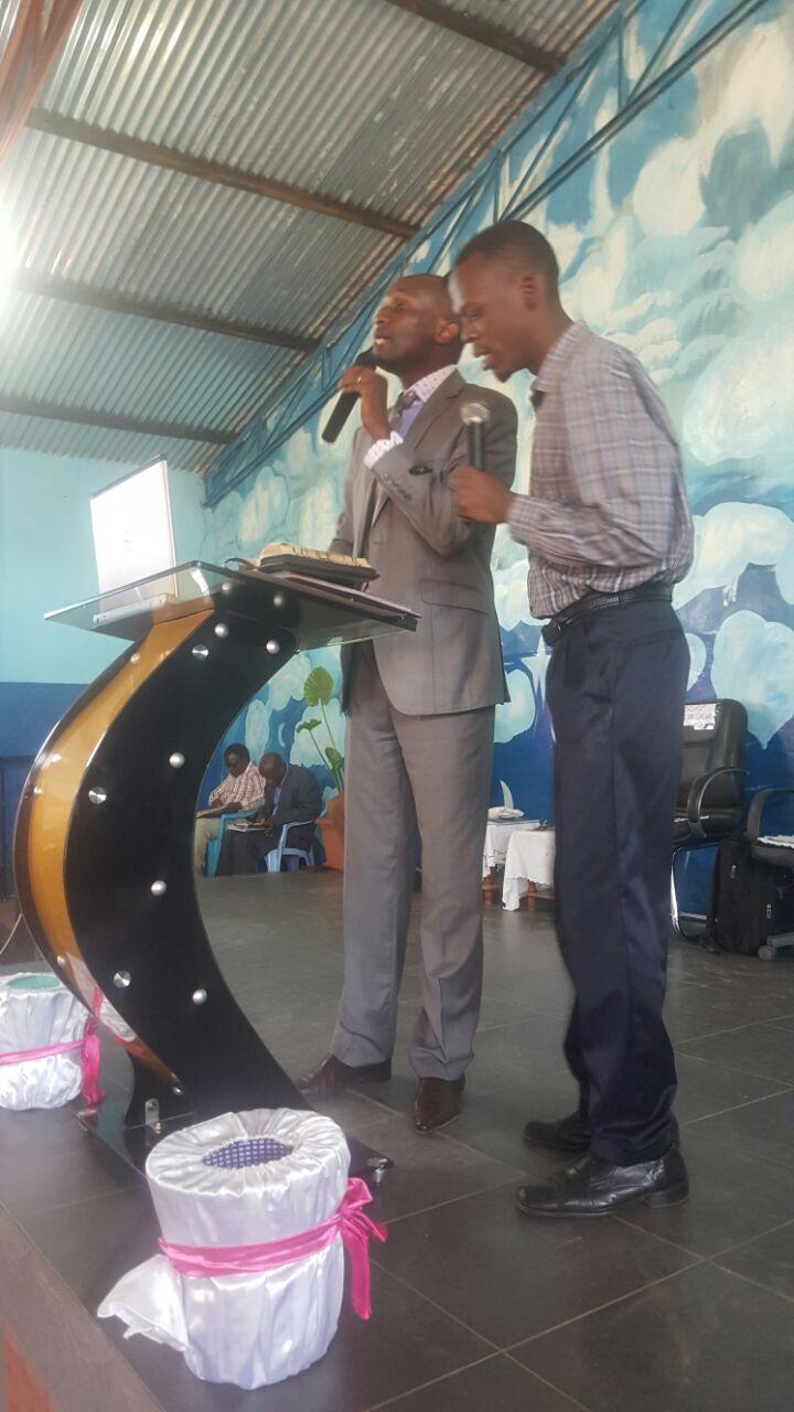 Apostle Kelvin addressing the gathering