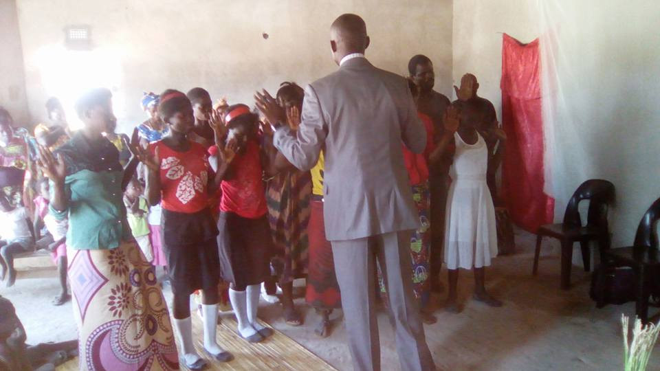 Apostle Kelvin leading this group in prayer to receive Jesus Christ as their Lord and Savior in Kitwe