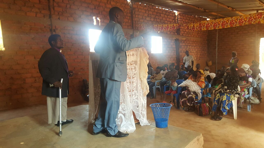 Apostle Kelvin sharing the Word in Lubumbashi with Pastor Gift interpreting
