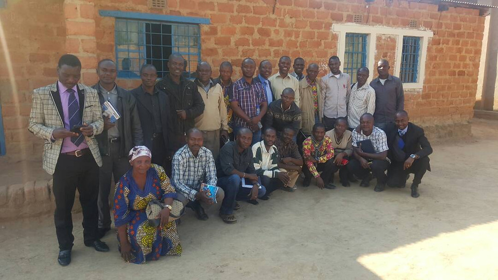 Jim & Kelvin pose with the pastors and leaders gathered for the seminar for the establishment of FBTC in DR Congo