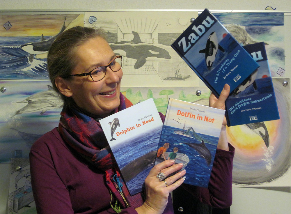 Doris Thomas with her books.jpg