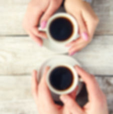 Cups with a coffee in the hands of men a