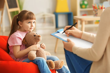 Cute little girl at child psychologist's