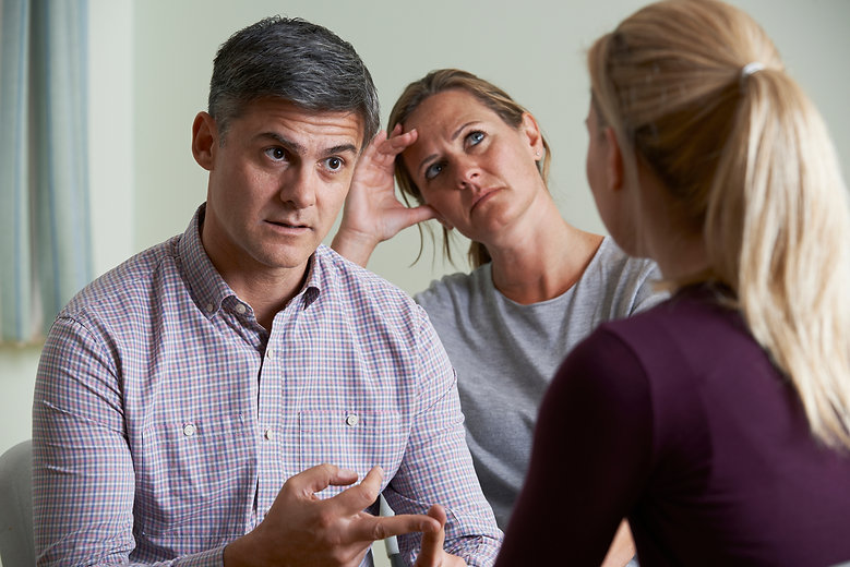 Couple Discussing Problems With Relationship Counsellor.jpg