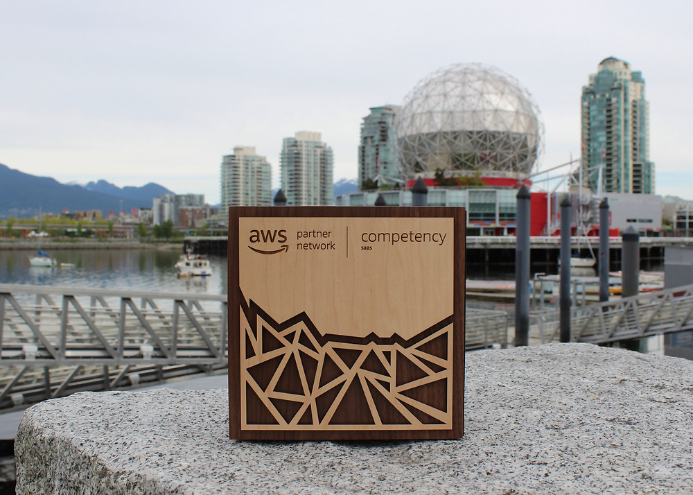 Amazon Web Services SaaS Competency plaque in front of Science World in Vancouver, BC, Canada
