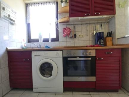 26 Küche mit Einbauküche
