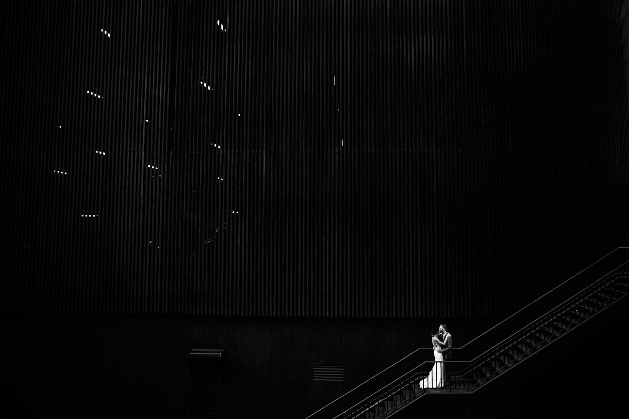 newlyweds embracing on steps denver