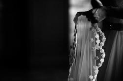 bride's hands holding veil