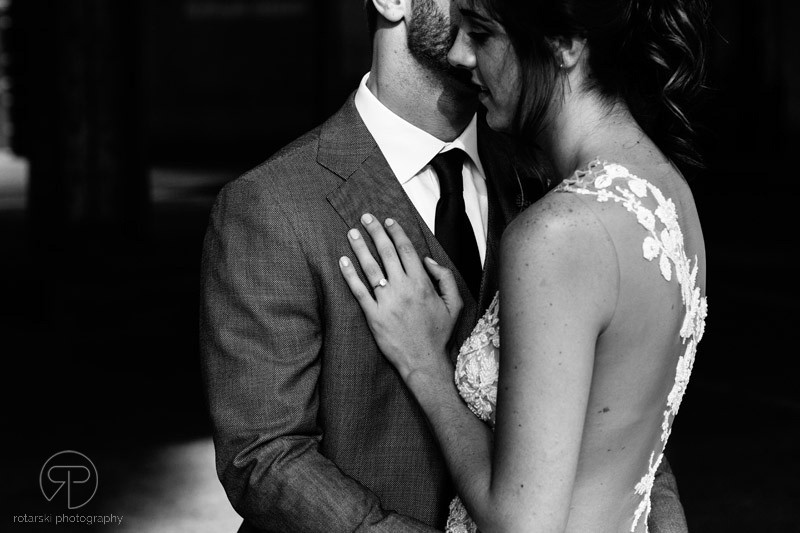 artsy-bride-groom-underpass-portrait-shadows-moody-dark-river-north-chicago-wedding-photographer-rotarski-photography