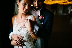 newlywed embrace in a barn dim light