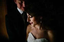 dim light couple wedding portrait