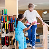 Physical therapist assessing senior on stairs
