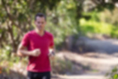 man-running-on-path-surrounded-with-tree