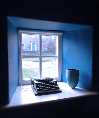 Well-known corners typewriter in a blue window