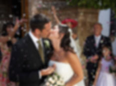 Happy Bride and Groom in confetti shower outdoors the church | marriage at city hall paphos cyprus