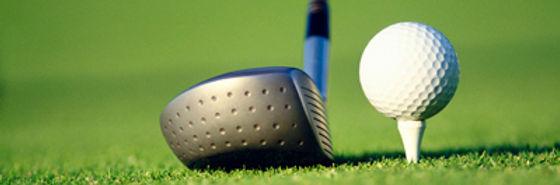 a golfer using a driver to ht a gof ball