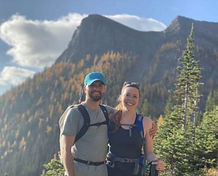 Alyssa and her Partner on vacation, by the mountains.
