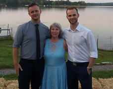 Micheline and her sons on vacation by the water.