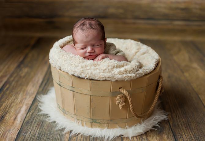 Фотосессия новорожденных с выездом