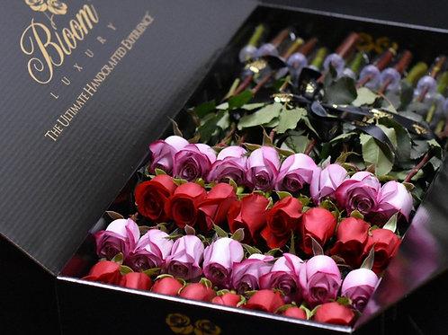 красные и розовые розы в длинных коробках
