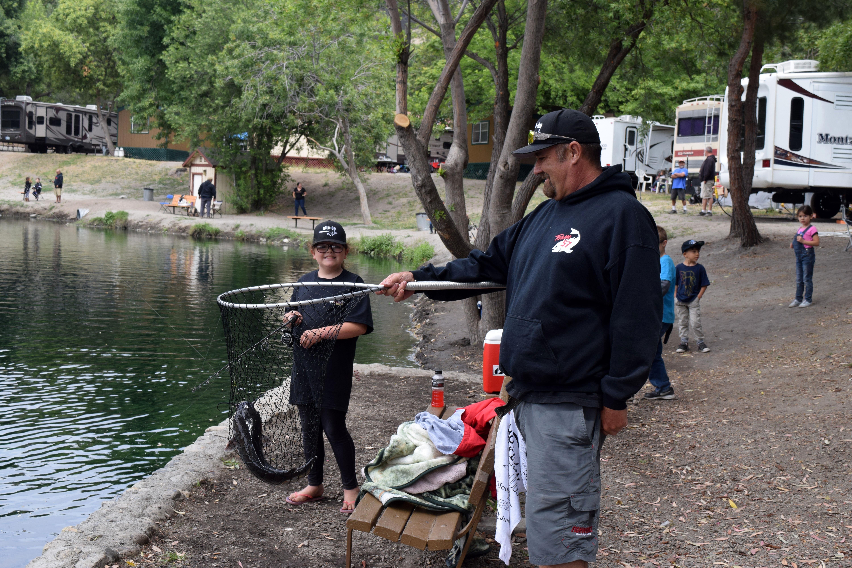 Members posing with fish