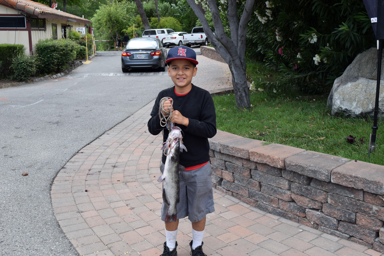 Member posing with fish